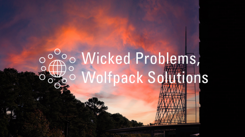 Text reads Wicked Problems, Wolfpack Solutions over a sunset backdrop.