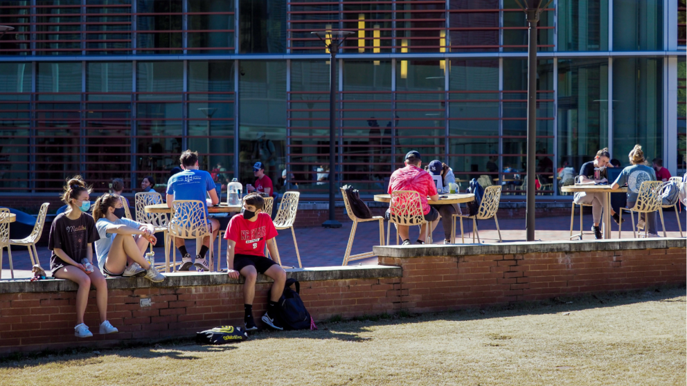 Students picnic in the warm sun at the Court of North Carolina as pleasant weather arrives for the spring 2021 semester.