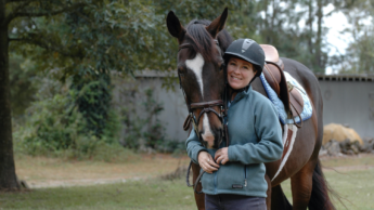 Temple embraces her former horse, Eros.