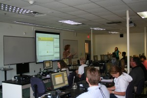 Lisa Fiedor instructs faculty members how to make a custom banner in Moodle using Adobe Fireworks.