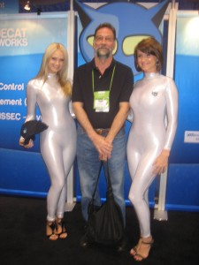 Marty Dulberg with the models working at the Blue Cat Networks Booth (they were giving out cool hats!)