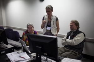 Amanda Robertson and Cathi Phillips work with instructors in the Open Lab session