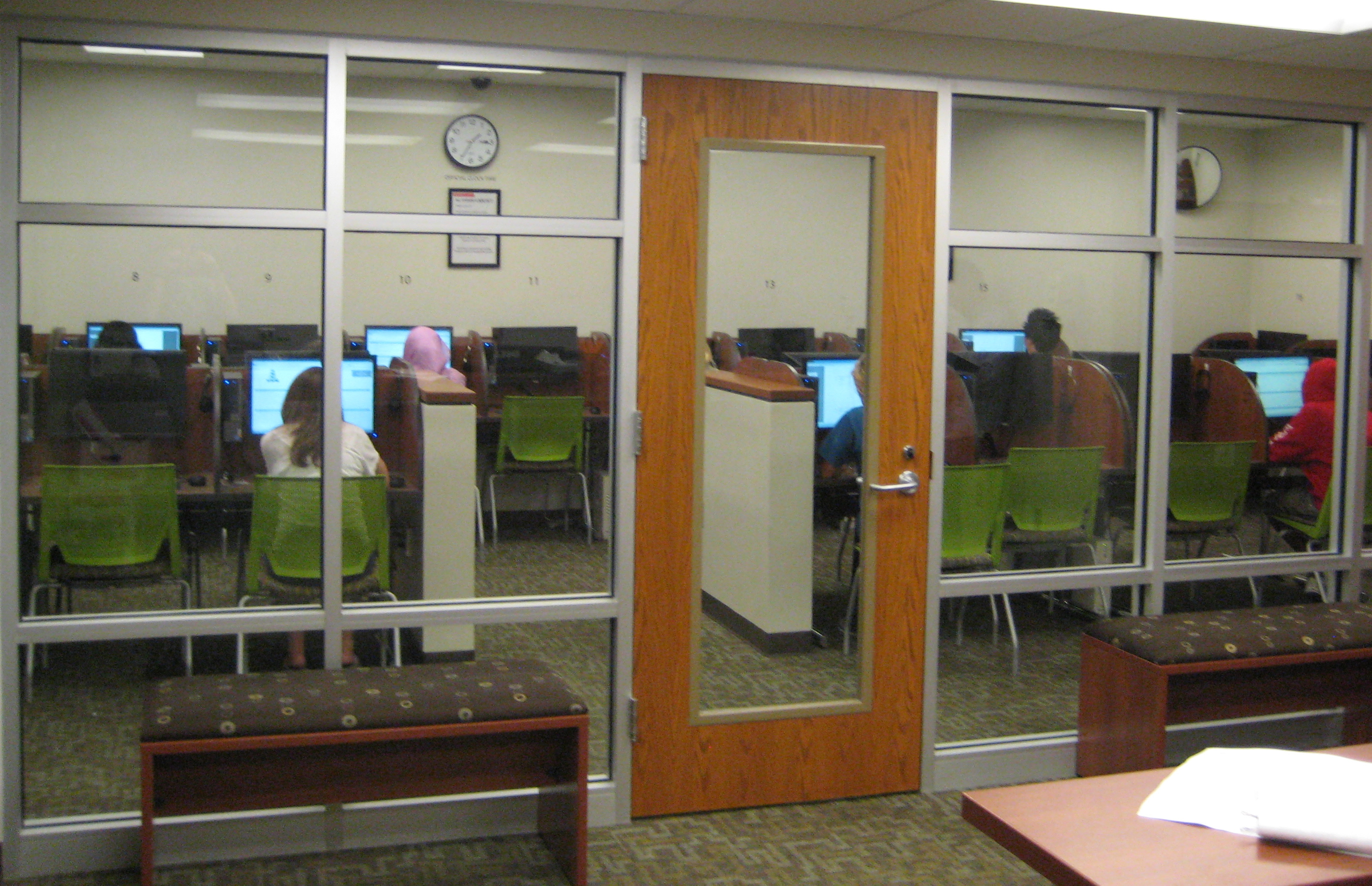 The glass wall allows proctors get a broad view of students testing.