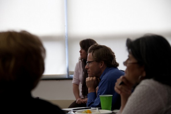An attendee listens intently to the presentation