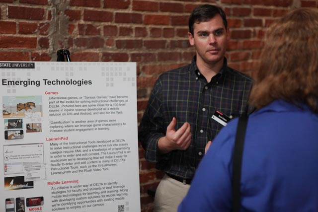 Scott DuBois, Web UI Designer/Developer, discusses Emerging Technologies with an Open House attendee