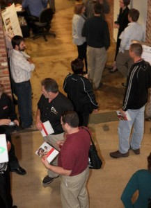Guests stroll Presentation Hallway, learning about the various services DELTA provides